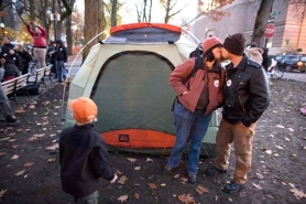 by: Christopher Onstott Dan White and Erin Niemi kiss after setting up their tent in the South Park Blocks Saturday afternoon. The Occupy Portland campers hope to stay in the park blocks for two weeks.