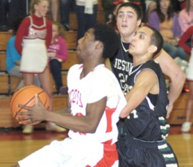 by: David Ball Sirgio Palmore of David Douglas drives to the basket vs. Jesuit on Tuesday night.
