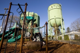 by: CHRISTOPHER ONSTOTT Madrona Schubert, 5, plays under two large water towers at Sabin Hydro Park in Northeast Portland. The park, funded through Portlanders' water bills, is one of many city commissioner pet projects that critics say shouldn't have been billed to sewer and water ratepayers.