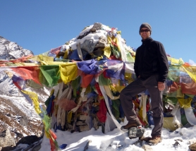 by: Courtesy of Jim Ronning Donovan Pacholl, standing near prayer flags, has made a career of introducing other folks to high adventure. Recently, he returned from leading a group to the top of Kala Patthar, 18,192 feet, near the Mount Everest base camp. No elephants were sighted, this time.