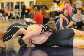 by: SUBMITTED PHOTO Braden Krellwitz takes on an opponent at the Newberg Tournament last week. He is one of four returning state qualifiers for the Lions this year.