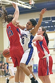 by: Miles Vance IN TRAFFIC — Valley Catholic freshman Kaylynn Bush loses the ball while sandwiched between La Salle's Andrea Novak (left) and Makenzie Cook on Monday.