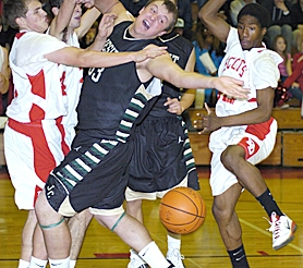 by: David Ball IN DEEP — Jesuit center Max Rich Max loses the ball after being fouled under the basket in a crowd of David Douglas defenders Tuesday night.