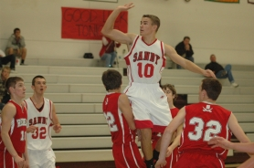 by: Kris Anderson Jacob Groom drives to the basket during Sandy's 101-88 win over South Albany in the championship game of the Sandy Tournament last Saturday.