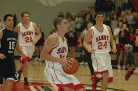 by: Kris Anderson Jacob Groom led Sandy with 21 points and three assists. He was 4-of-6 from both two-point and three-point range during Sandy's 85-63 win over Hood River Valley.