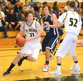 by: John Brewington BASELINE DRIVE—St. Helens' Jake Ramiskey drives the ball to the hoop during last Tuesday's game with Hood River Valley. The Lions posted a 70-61 win and would add another over Madison on Friday night.