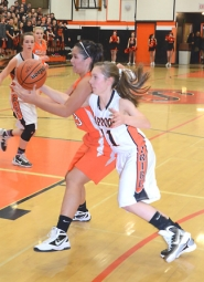 by: John Brewington MAKING A GRAB—Scappoose's Julia Grabhorn sneaks a hand in for the ball during last Friday's game with Molalla. The Indians won the game.