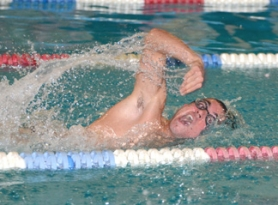 by: John Brewington HEADED FOR HOME—St. Helens' Will Lawrence leads the pack in the 50 free during last Thursday's meet with Sandy. Lawrence and the Lions want a district title this season.
