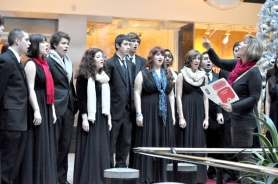 by: Contributed photo Members of Gresham High's Overtones choir sing at Pioneer Place in downtown Portland Dec. 9 as Janine Kirstein directs. The school's nationally recognized program has four concerts this week.