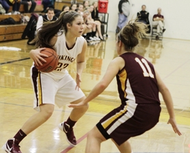 by: Chase Allgood Forest Grove sophomore Madi Andresen looks for an opening against The Dalles-Wahtonka during last Friday's game.