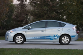 by: Courtesy of Toyota Motors The PLUG-IN HYBRID decal is not mandatory, unless you want  