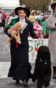 by: VERN UYETAKE Ruth Offer and her dog, Clarence, parade down Willamette Falls Drive.