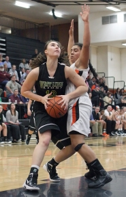 by: MILES VANCE West Linn's Mikayla Kraemer drives to the hoop in West Linn's loss to Beaverton on Tuesday. The Lions held a lead early in the second quarter before the Beavers took over, dropping the Lions to 1-4 on the season..