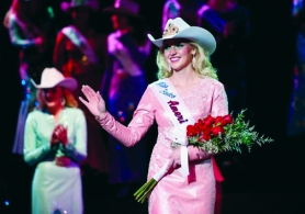 by: Submitted photo WINNERS WALK — Miss Rodeo Oregon Mackenzie Carr, from Vernonia, cheerfully accepts her new role as Miss Rodeo America in front of thousands in Las Vegas during the culmination of the week-long pageant. Carr beat out 