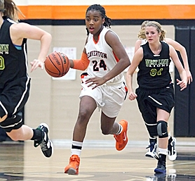by: Miles Vance ON THE MOVE — Beaverton's Alexis Montgomery races upcourt during her team's 62-41 win over West Linn on Tuesday at Beaverton High School.