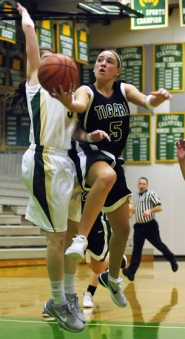 by: DAN BROOD TO THE HOOP — Tigard sophomore guard Lexi Carter (right) drives hard to the basket against Jesuit's Rachel Mendelsohn in Tuesday's game. Tigard won 49-32.
