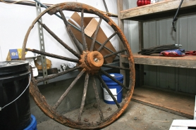 by: File photo A backhoe operator discovered this old wagon wheel buried near the Sandy River at the bridge work site in Troutdale. The wheel was located near the location of an old wagon road. So far, people are guessing that the wheel could be 150 years old.