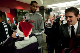 by: CHRISTOPHER ONSTOTT Trail Blazers forward LaMarcus Aldridge signs autographs at Friday's Fan Fest.