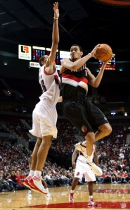 by: CHRISTOPHER ONSTOTT Armon Johnson (right) tries to make a move against Nicolas Batum during Friday night's Trail Blazers Fan Fest at the Rose Garden.