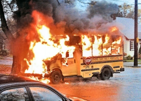 by: Courtesy of James Barta <i>BEE</i> reader James Barta photographed the small school bus while it was fully involved in flames, as dawn broke at about at S.E. 18th and Claybourne in Westmoreland.