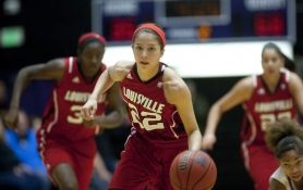by: CHRISTOPHER ONSTOTT Louisville guard Jude Schimmel leads the Cardinals up the court in Saturday's victory at the University of Portland.