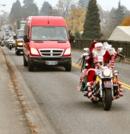 by: David F. Ashton Yes, it's Santa – riding a decked-out bike, and leading the Shriners' Hospital van across the Sellwood Bridge!