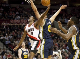 by: CHRISTOPHER ONSTOTT Trail Blazers reserve guard Elliot Williams draws a foul on a drive Monday night against the Utah Jazz.