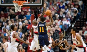by: CHRISTOPHER ONSTOTT New Trail Blazers guard Jamal Crawford goes to block a shot by Utah's Earl Watson as Portland wins its preseason opener at the Rose Garden 110-90 Monday night.
