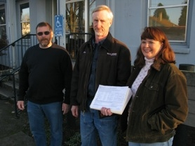 by: raymond rendleman Kevin Johnson, who is chief petitioner for ballot measures inspired by library plans, is joined by Kim Sieckmann (left) and Tammy Stempel before turning in more than 500 signatures on each petition.