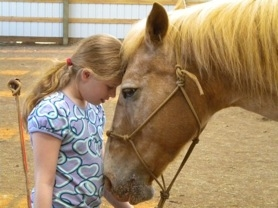 by: submitted photo Hope Shoemate shares a moment with Zena at Big Star Ranch in Beavercreek.