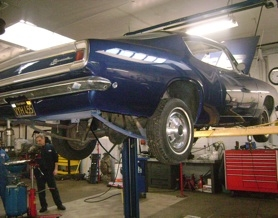 "by: ellen Spitaleri Edwin Claudio's ""dream car,"" a dark blue Barracuda, is being restored at Bernard's Garage in Milwaukie."