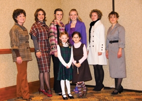 by: Courtesy photo The Isaacson family of Banks has once again garnered honors for its sewing prowess. Grace, 7, and Lydia, 6, (front row, above) placed well in an Oregon competition.