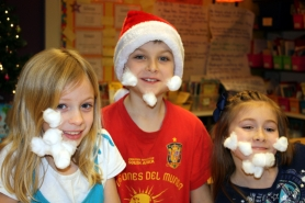 by: LORI HALL Third-graders have a jolly good time mimicking Santa Claus during a Stafford Primary School holiday party.