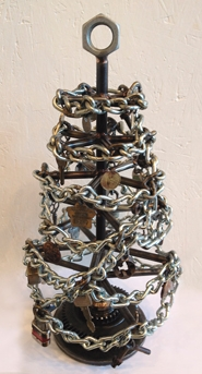 "by: Submitted photo ""Tree"" by Joe Pogan, in found metal, is one of the holiday trees on view at Art on Broadway Gallery, in downtown Beaverton."