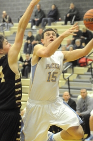 by: MATTHEW SHERMAN Brandon Loiler makes a move to the hoop in Lakeridge's semifinal victory over Milwaukie on Tuesday.