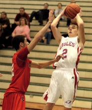 by: David Ball Centennial guard Cam Croonquist puts up a fadeaway jumper Wednesday.