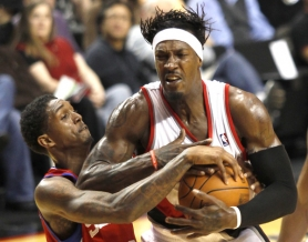 by: JAIME VALDEZ Trail Blazers forward Gerald Wallace grimaces while being fouled by Philadelphia's Louis Williams in the fourth quarter of Monday night's season opener at the Rose Garden.