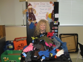 by: Submitted photo courtesy of Providence <b>LOADS OF GLOVES</b> — Gina Jackson, a patient relations representative at Providence Medical Group-Sherwood, displays some of the 180 pairs of gloves she helped collect for the Union Gospel Mission and distributed them on Thanksgiving Day.