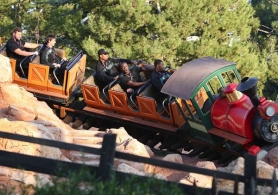 by: PAUL HIFFMEYER Rose Bowl-bound Oregon Ducks players ride the Big Thunder Mountain Railroad during a visit Tuesday to Disneyland.