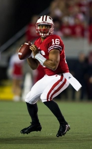 by: DAVID STLUKA Former North Carolina State two-sport athlete Russell Wilson tried pro baseball, then transferred to Wisconsin for a final season of college quarterback. He has led the Badgers to the Rose Bowl game Jan. 2 against Oregon.