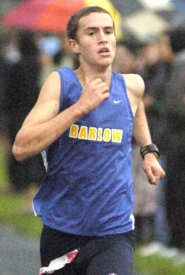 by: file photo Barlow's Jackson Haselnus closes in on the finish line during a cross country race in the fall.