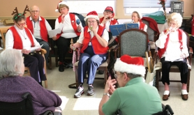 by: Jim Clark The Hot Shots perform at Village Health Care in Gresham on Thursday, Dec. 22,