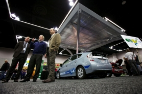 by: JAIME VALDEZ James D. Holbery, left, president and founder of Grid Mobility, Hans van der Meer of EV4 and A. Mark Walter of Christenson Electric Inc., unveiled a prototype electric vehicle charging station at last year's International Portland Auto Show. Designed by EV4 Oregon and installed by Christensen Electric, the large, mushroom-shaped structure uses solar panels to directly charge vehicles or store electricity in batteries for later use.
