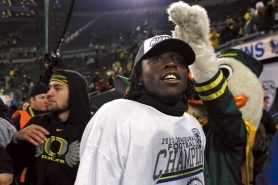 by: JAIME VALDEZ De'Anthony Thomas shows off the Oregon Ducks' 2011 Pac-12 championship hat and T-shirt after the title game victory over UCLA.