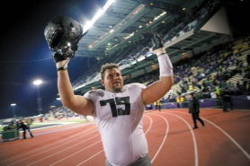 by: CHRISTOPHER ONSTOTT Senior Mark Asper, celebrating this season's victory at Husky Stadium, settled in at right guard after playing tackle in the Oregon Ducks' season-opening loss to LSU.
