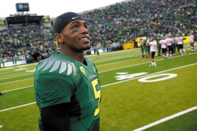 by: CHRISTOPHER ONSTOTT Junior Darron Thomas says he's pleased with how he has helped set up plays for Oregon's running backs this season.