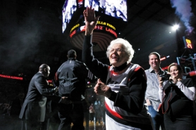 by: JAIME VALDEZ Sally Williams, 80, of Hermiston, who has been a die-hard Trail Blazers fan for 40 years, high-fives the starters during pre-game introductions Monday at the Rose Garden.