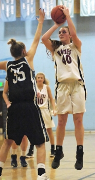 by: DAN BROOD UP FOR TWO — Tualatin senior post Taryn O'Neill (right) shoots over Lakeridge's Ellee Daskalos. O'Neill had 12 points and 16 rebounds in the Wolves' win.