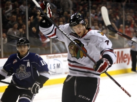 by: JAIME VALDEZ Winterhawks defenseman Joe Morrow celebrates scoring the first goal of Wednesday's 6-3 win over Victoria at the Rose Garden.