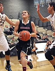 by: Miles Vance IN THE MIDDLE — Southridge junior Tiffany Backman drives to the basket on Tuesday at Lakeridge High.